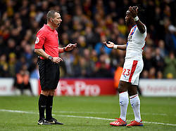 Crystal Palace's Michy Batshuayi (right) has words with referee Kevin Friend