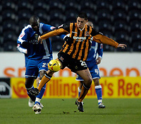 Photo: Jed Wee.<br />Hull City v Cardiff City. Coca Cola Championship.<br />03/12/2005.<br />Hull's Billy Paynter (R) gets to the ball ahead of Cardiff's Michael Ricketts.