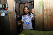 Ecuador, May 15 2010: A young Cofan girl smiles for the camera. Images from Cofan Lodge. Copyright 2010 Peter Horrell