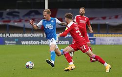 Frankie Kent of Peterborough United in action with Jordan Stevens of Swindon Town - Mandatory by-line: Joe Dent/JMP - 03/10/2020 - FOOTBALL - Weston Homes Stadium - Peterborough, England - Peterborough United v Swindon Town - Sky Bet League One