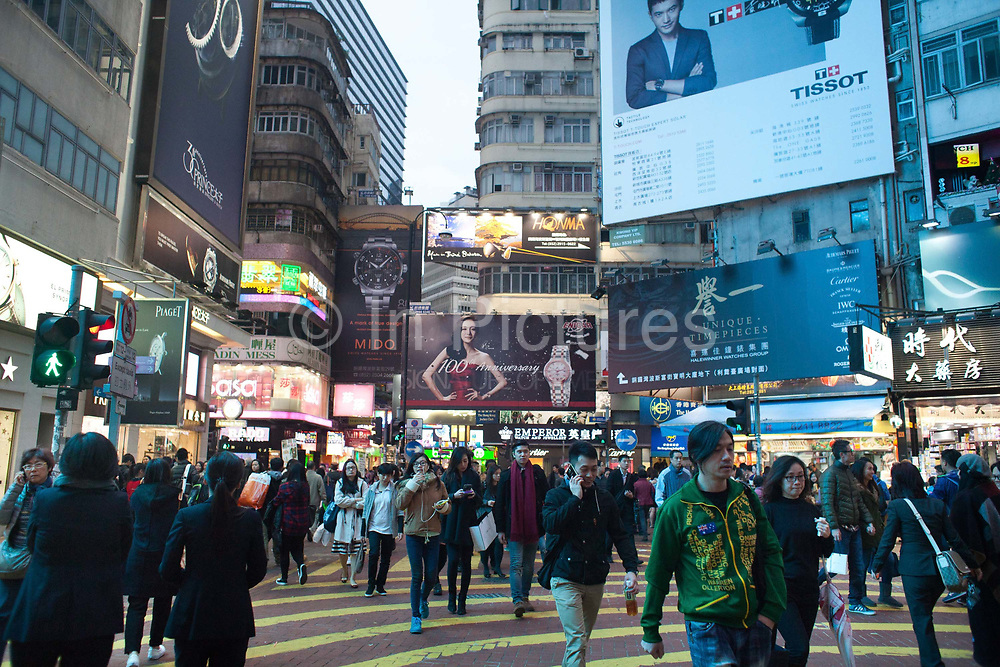 Shoppers mill about in Times Square, Wan Chai. 7 million people live on 1,104km square, making it Hong Kong the most vertical city in the world.