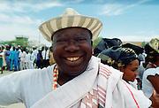A happyl, smiling Nigerian man waiting for friends at Maiduguri Airport in Nigeria