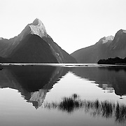 Mitre Peak at sunrise. Mitre Peak is an iconic mountain in the South Island of New Zealand. It is one of the most photographed peaks in the country. Close to the shore of Milford Sound, in the Fiordland National Park, rising to 1,692 metres from the water of the sound. it is actually a closely grouped set of five peaks, although from most easily accessible viewpoints it appears as a single point. Milford Sound, New Zealand. Photo Tim Clayton
