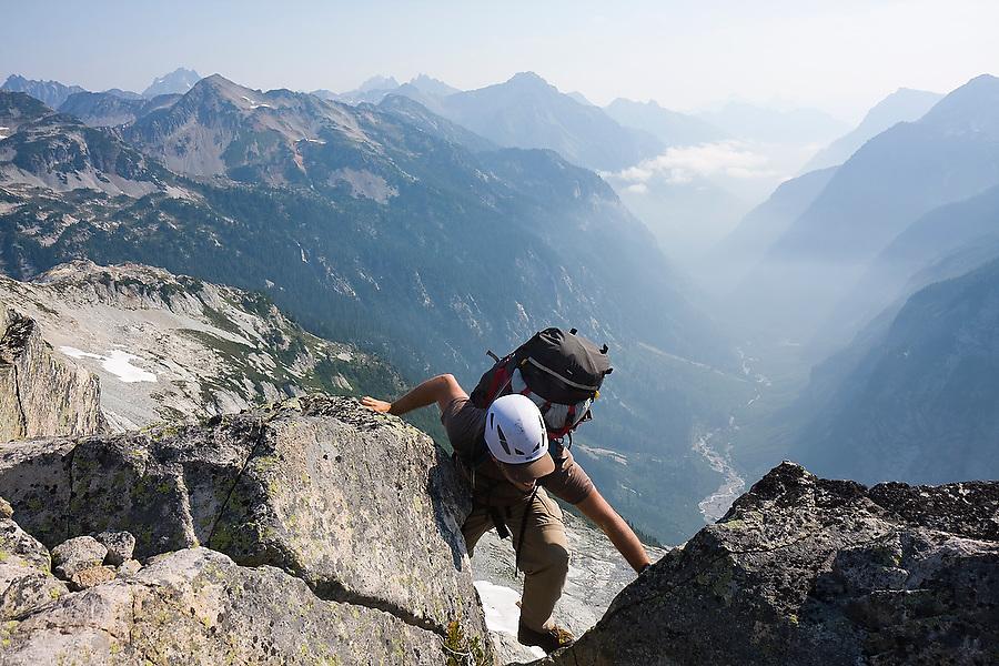 Jim Prager scrambles up Whatcom Peak in North Cascades National Park, Washington.