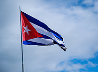 SANTIAGO DE CUBA, CUBA - CIRCA JANUARY 2020: Cuban flag in the Santa Ifigenia Cemetery in Santiago de Cuba. This is the resting place of a few notable Cubans, including Jose Marti and Fidel Castro among others.