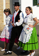 Men and women in traditional Svab dress at the wine harvest festival, Hajos (Hajós) Hungary .<br /> <br /> Visit our HUNGARY HISTORIC PLACES PHOTO COLLECTIONS for more photos to download or buy as wall art prints https://funkystock.photoshelter.com/gallery-collection/Pictures-Images-of-Hungary-Photos-of-Hungarian-Historic-Landmark-Sites/C0000Te8AnPgxjRg