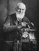 William Thomson, Lord Kelvin (1824-1907), Scottish mathematician and physicist. Kelvin with his compass. From photogrpah taken in 1902