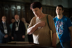 """3 June 2018, Novi Sad, Serbia: A congregant prays as they await Sunday service in the Eastern Orthodox Cathedral Church of the Holy Great Martyr George. On 31 May - 6 June 2018, in Novi Sad, Serbia, the Serbian Orthodox Church stood as one of the host churches of the Conference of European Churches General Assembly. More than 400 delegates, advisors, stewards, youth, staff, and distinguished guests took part in the Assembly and related events, gathered under the theme, """"You shall be my witnesses""""."""