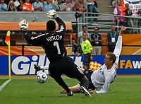 Photo: Glyn Thomas.<br />England v Trinidad & Tobago. Group B, FIFA World Cup 2006. 15/06/2006.<br /> England's Peter Crouch (R) has a shot saved by Shaka Hislop.