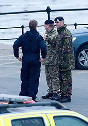 © Licensed to London News Pictures. 13/03/2012. Saltburn, England. Police, military and emergency response units on the seafront at Saltburn, Cleveland today (13/02/2012) where armed police surrounded a person suspected of carrying a bomb in a bag. Photo credit : Ian Forsyth/LNP