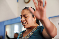 A churchgoer is lost in Easter music at Fuente de Vida Church in east Salinas.