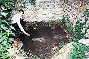 Teenage boy brushing soil from surface of Roman mosaic, Spoonley Wood Roman Villa, Gloucestershire, England in 1966