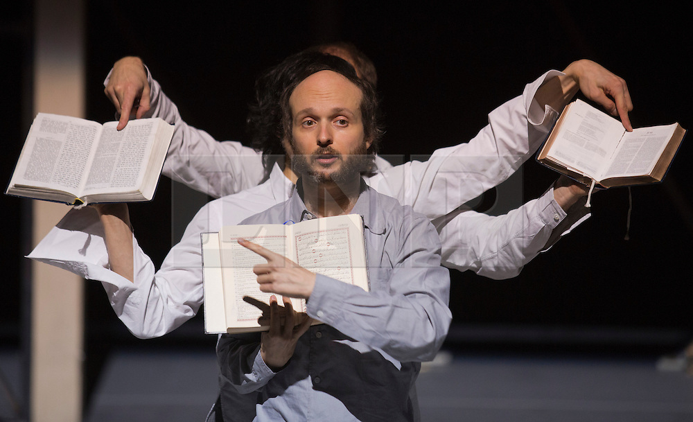 """© Licensed to London News Pictures. 24/01/2014. London, England. Pictured: Sidi Larbi Cherkaoui dancing with religious books such as the Koran and the Bible. Belgian dancer/choreographer Sidi Larbi Cherkaoui's work """"Apocrifu"""" uses the language of the body to explore apocryphal religious texts, accompanied by the polyphonic singing from the all-male Corsican vocal ensemble """"A Filetta"""". Dancers: Sidi Larbi Cherkaoui, Dimitri Jourde and Yasuyuki Shuto. Performances at the Queen Elizabeth Hall, Southbank Centre from 24th to 25the January 2014. Photo credit: Bettina Strenske/LNP"""