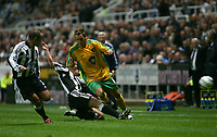 Photo. Andrew Unwin.<br /> Newcastle United v Norwich, Barclays Premiership, St James Park, Newcastle upon Tyne 25/08/2004.<br /> Newcastle's Andy O'Brien (C) puts in an excellent sliding challenge to dispossess Norwich's Darren Huckerby (R)