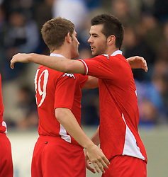 REYKJAVIK, ICELAND - Wednesday, May 28, 2008: Wales' goalscorer Ched Evans celebrates with provider Joe Ledley against Iceland during the international friendly match at the Laugardalsvollur Stadium. (Photo by David Rawcliffe/Propaganda)