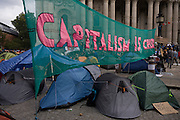 The Occupy London protest enters it's third day with the setting up of a camp city in St. Paul's Churchyard, below the famous Cathedral in the City of London, the capital's financial district. A long banner declares that Capitalism is in Crisis below a few of the gathering small tents