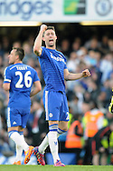 Gary Cahill of Chelsea celebrates his teams win after the final whistle. Barclays Premier league match, Chelsea v Manchester Utd at Stamford Bridge Stadium in London on Saturday 18th April 2015.<br /> pic by John Patrick Fletcher, Andrew Orchard sports photography.