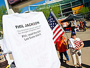 "25 MAY 2010 - PHOENIX, AZ: Picketers in front of US Airways Arena in Phoenix, Tuesday, May 25. They claim Lakers' coach Phil Jackson supports the new law. People opposed to illegal immigration and in favor of Arizona SB1070 picket the Phoenix Suns playoff game against the Los Angeles Lakers Tuesday. About 10 people attended the protest. One person opposed to SB1070 held a counter demonstration. SB1070 makes it an Arizona state crime to be in the US illegally and requires that immigrants carry papers with them at all times and present to law enforcement when asked to. People are picketing the Suns games because Suns owner Robert Sarver has expressed opposition to the law and has had the Suns wearing jerseys that say ""Los Suns.""  PHOTO BY JACK KURTZ"