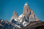 North face of Mount Fitz Roy (3405 m or 11,171 ft elevation) and Aguja Poincenot (left) in Los Glaciares National Park, Santa Cruz Province, Argentina, Patagonia, South America. Photographed from the trail to Huemul Lake and Glacier (4 km round trip with 215 m gain) on private land. Pay the trail entrance fee at the campground at Estancia Lago Del Desierto. Directions: drive north from El Chalten for 35 km on gravel road RP23, leaving the national park, to reach Punta Sur of Lago del Desierto, in Santa Cruz Province, Argentina, Patagonia, South America.