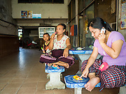 """11 JUNE 2015 - MAHACHAI, SAMUT SAKHON, THAILAND: Women who live in a tenement building used for Burmese migrant housing relax in the common space in the building. Labor activists say there are about 200,000 migrant workers from Myanmar (Burma) employed in the fishing and seafood industry in Mahachai, a fishing port about an hour southwest of Bangkok. Since 2014, Thailand has been a Tier 3 country on the US Department of State Trafficking in Persons Report (TIPS). Tier 3 is the worst ranking, being a Tier 3 country on the list can lead to sanctions. Tier 3 countries are """"Countries whose governments do not fully comply with the minimum standards and are not making significant efforts to do so."""" After being placed on the Tier 3 list, the Thai government cracked down on human trafficking and has taken steps to improve its ranking on the list. The 2015 TIPS report should be released in about two weeks. Thailand is hoping that its efforts will get it removed from Tier 3 status and promoted to Tier 2 status.        PHOTO BY JACK KURTZ"""