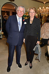 LORD & LADY MAGAN at the London debut of Nest - an organisation to promote peace and prosperity in partnership with artisans worldwide, held at Thomas Goode & Co, South Audley Street, London on 4th November 2014.