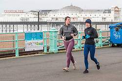 © Licensed to London News Pictures. 20/02/2021. Brighton, UK. People can be seen exercising on the Brighton and Hove Promenade as the Corona Virus Lockdown continues across the United Kingdom. Photo credit: Hugo Michiels/LNP