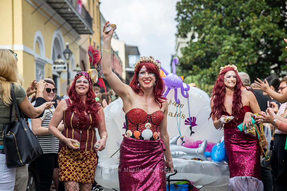 Krewe of Cork mermaids, from left, Tracey Kimbrell, Katy Kimbrell and Ashley Lindsay parade through the French Quarter. Founded in 2000, the Krewe of Cork has grown into a world famous Mardi Gras parade and celebration of wine, food and fun.