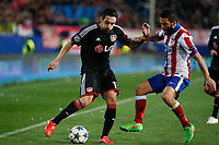 Atletico de Madrid´s Arda Turan (R) and Bayer 04 Leverkusen´s Hilbert during the UEFA Champions League round of 16 second leg match between Atletico de Madrid and Bayer 04 Leverkusen at Vicente Calderon stadium in Madrid, Spain. March 17, 2015. (ALTERPHOTOS/Victor Blanco)