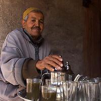 Africa, Morocco, Imlil. Moroccan Berber Villager serving Mint Tea.