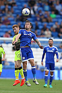 Joe Ralls of Cardiff city jumps for a header with Stephen Quinn of Reading.  EFL Skybet championship match, Cardiff city v Reading at the Cardiff city stadium in Cardiff, South Wales on Saturday 27th August 2016.<br /> pic by Andrew Orchard, Andrew Orchard sports photography.