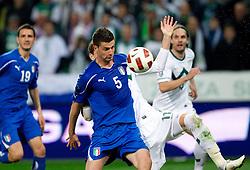 Thiago Motta of Italy and Milivoje Novakovic of Slovenia during EURO 2012 Quaifications game between National teams of Slovenia and Italy, on March 25, 2011, SRC Stozice, Ljubljana, Slovenia. Italy defeated Slovenia 1-0.  (Photo by Vid Ponikvar / Sportida)