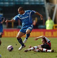 Photo: Tony Oudot/Richard Lane Photography. Gillingham v Shrewsbury Town. Coca-Cola Football League Two. 28/02/2009. <br /> Simeon Jackson of Gillingham is tackled by David Worrall of Shrewsbury