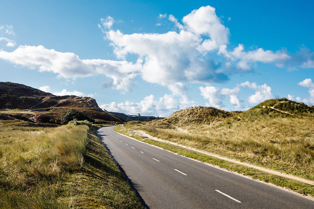 The Five Mile Road, winding through the sand dunes of St Ouen's Bay on the west coast of Jersey, Channel Islands