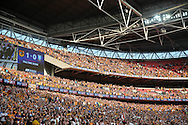 Hull City fans celebrate in the stands after their team win promotion to the Premier league. Skybet football league Championship play off final match, Hull city v Sheffield Wednesday at Wembley Stadium in London on Saturday 28th May 2016.<br /> pic by John Patrick Fletcher, Andrew Orchard sports photography.