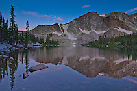 Reflections of the Snowy Range in Lake Marie.  Medicine Bow Mountains.  Wyoming, USA.