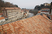 """Cittadellarte building exterior views with river at Biella<br /><br />Michelangelo Pistoletto (born 25 June 1933) is an Italian painter, action and object artist, and art theorist. Pistoletto is acknowledged as one of the main representatives of the Italian Arte Povera. His work mainly deals with the subject matter of reflection and the unification of art and everyday life in terms of a Gesamtkunstwerk<br /><br />In 1996, he founded the art city Cittadelarte – Fondazione Pistoletto in a discarded textile factory near Biella. Its objective, in brief, is """"to inspire and produce a responsible change in society by means of creative ideas and projects."""" Nowadays Pistoletto is particularly concerned with environmental issues, and to develop awareness about using only what we need and to create awareness about over consumption."""