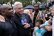 Celebrity conspiracy theorist David Icke is greted by adoring admirers as they gather in Trafalgar Square for an anti-lockdown and pro-personal freedom protest against the government and mainstream media who, they say, are behind disinformation and  untruths about the covid pandemic, on 29th August 2020, in London, England.