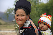 Vietnam, Sapa Market, Black Hmong woman and child in traditional dress