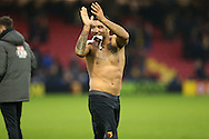Troy Deeney, the Watford captain with his shirt off walks around the pitch after full time to thank the Watford fans.Premier league match, Watford v Everton at Vicarage Road in Watford, London on Saturday 10th December 2016.<br /> pic by John Patrick Fletcher, Andrew Orchard sports photography.