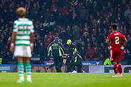 Players from both teams look on as security wrestles with a pitch invader during the Betfred Cup Final between Celtic and Aberdeen at Celtic Park, Glasgow, Scotland on 2 December 2018.