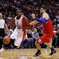 21 January 2012: Miami Heat power forward Chris Bosh (1) drives past Philadelphia Sixers center Nikola Vucevic (8) during the Miami Heat 113-92 victory over the Philadelphia Sixers at the AmericanAirlines Arena, Miami, Florida, USA.