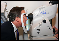 Prime Minister David Cameron tours the exhibition  at the Conservative Party Conference in Birmingham, Monday, 8th October October 2012. Photo by: Stephen Lock / i-Images