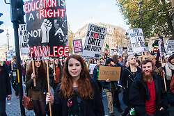 """London, November 19th 2014. Thousands of students march through central London, demanding that education fees are scrapped by the government. PICTURED: A young woman proclaims """"Education is a right not a privilege""""."""