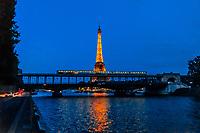 A Metro train crosses the RIver Seine over the Bir Hakeim Bridge, Paris, France.