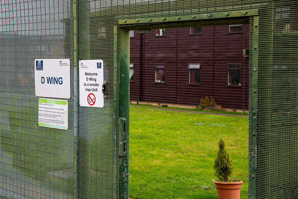 The entrance gate into D wing a smoke free unit at HMP Downview, Surrey, United Kingdom. HMP Downview is a women's closed category prison for adult sentenced women and convicted and remand female young people located on the outskirts of Banstead in Surrey, England. (Picture credit: © Andy Aitchison)