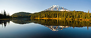 Panorama of Mount Rainier mirrored in Reflection Lakes in the evening light in Mount Rainier National Park.