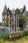 Knit art on poles. Oban is an important tourism hub and Caledonian MacBrayne (Calmac) ferry port, protected by the island of Kerrera and Isle of Mull, in the Firth of Lorn, Scotland, United Kingdom, Europe.