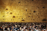 Israel, Jerusalem, Wailing Wall, Night shot of Jews during Selichot prayers. Selichot (Selihot?) are Jewish penitential poems and prayers, especially those said in the period leading up to the High Holidays.