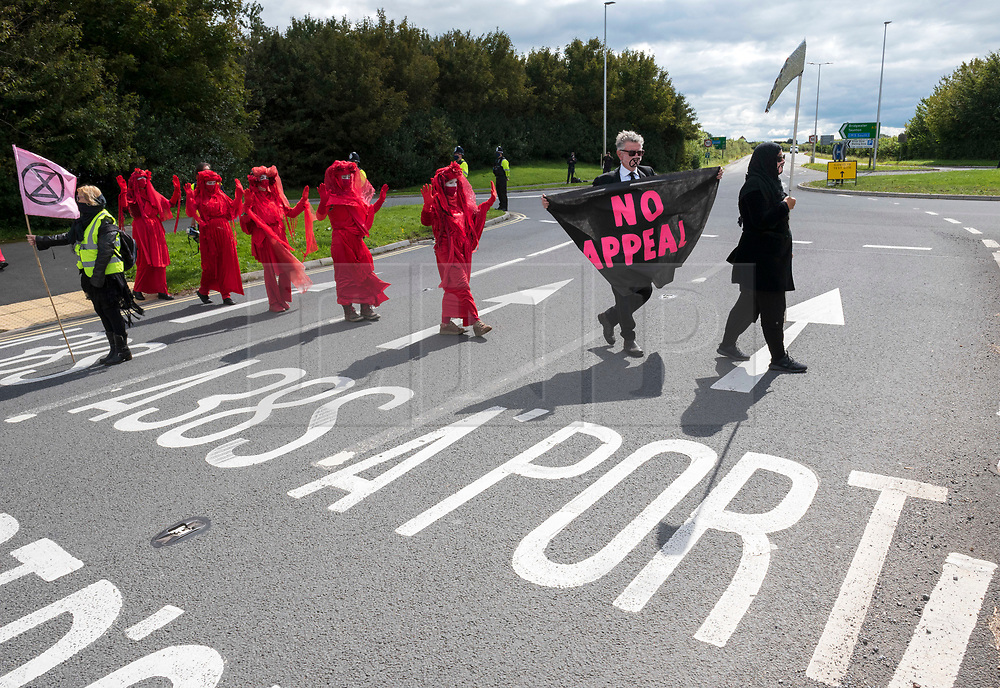 © Licensed to London News Pictures;29/08/2020; Bristol Airport, Lulsgate Bottom, UK. Common Ground with Extinction Rebellion protest at Bristol Airport against plans to expand the airport and against the airport's decision to appeal against a refusal by North Somerset Council over the expansion plans. This is on the second day of a bank holiday weekend of protest across the UK by Extinction Rebellion. XR are protesting in Bristol and other cities in the UK against climate change, leading up to a protest in London starting on 01 September. XR say that despite clear scientific evidence of the deadly climate and ecological emergency, the UK government are refusing to take the urgent action needed to avoid mass extinction. XR say we need politicians to support the Climate and Ecological Emergency Bill. During the coronavirus covid-19 pandemic, climate change is being forgotten but it is still an emergency that is happening, the elephant in the room. Photo credit: Simon Chapman/LNP.
