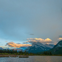 A sunset lights clouds over Mount Rundle and Vermillion Lakes in Banff National Park, Alberta, Canada.